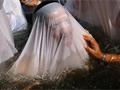 Tömeges keresztelő a Jordánban