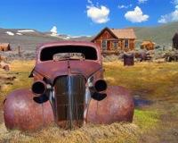 Rozsdás autó a mezőn. Forrás: Dave's Travel Corner